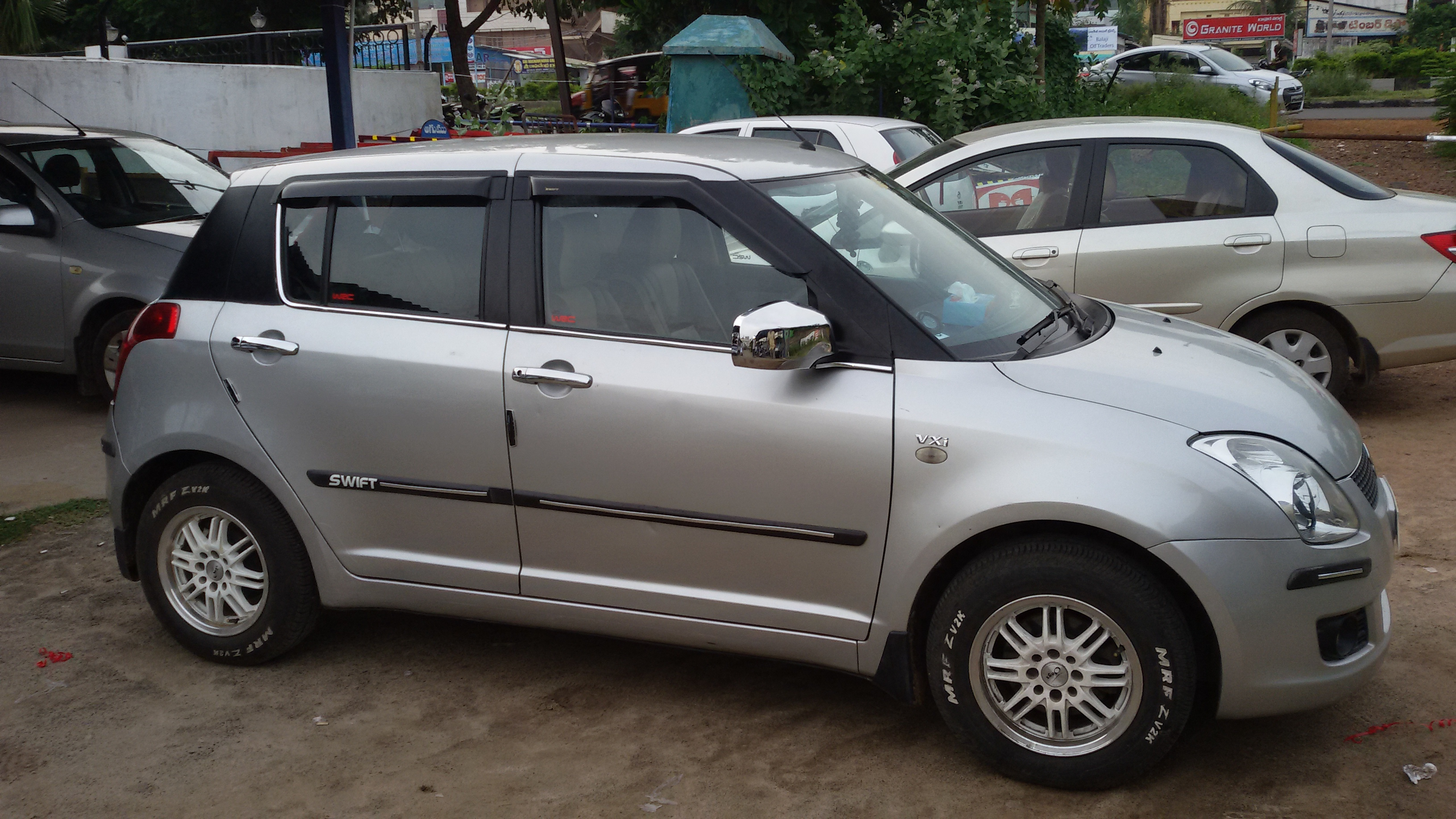 Maruti Suzuki Swift Zxi Photos Images And Wallpapers