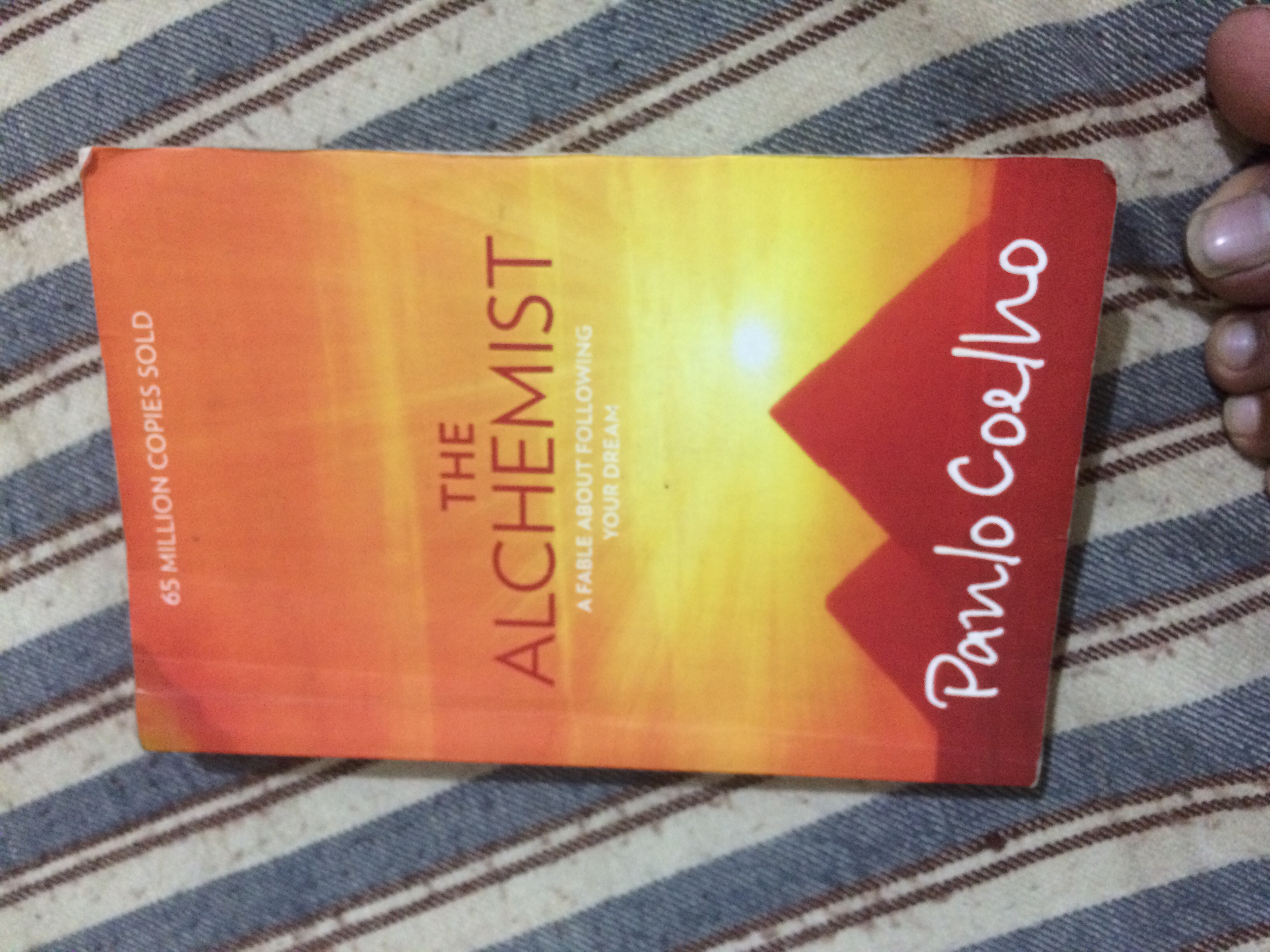 confusing themes and spiritual concepts in the alchemist a novel by paulo coelho Coelho's classic work is his first, the alchemist it is the tale of santiago, an andalusian shepherd boy who dreams of travelling the world to find treasure, and sets out to realise his dream.