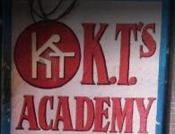 K. T.